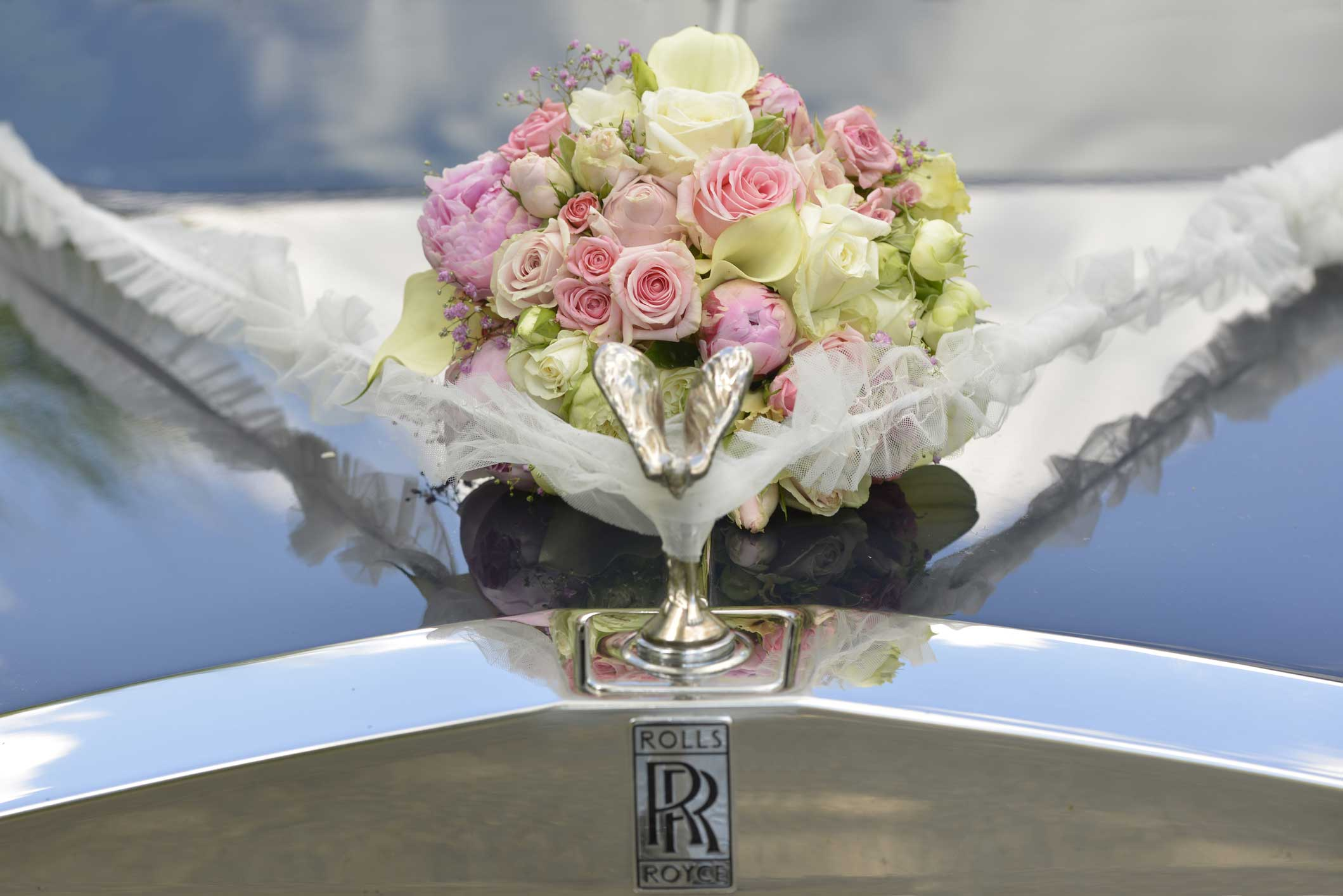 bouquet on hood of rolls