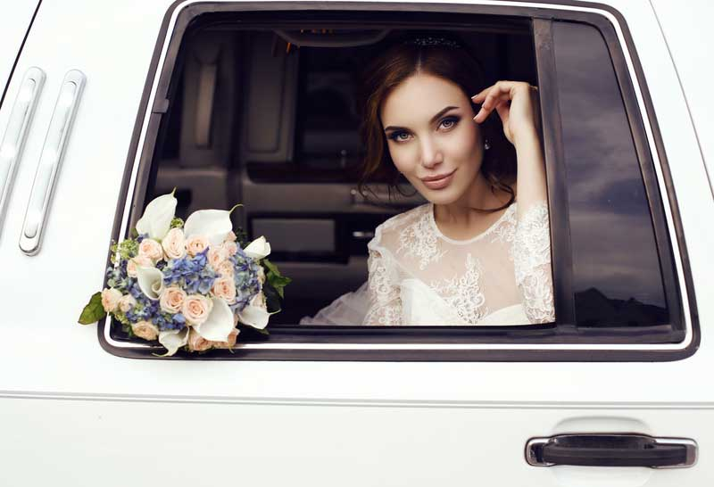 bride at window of car